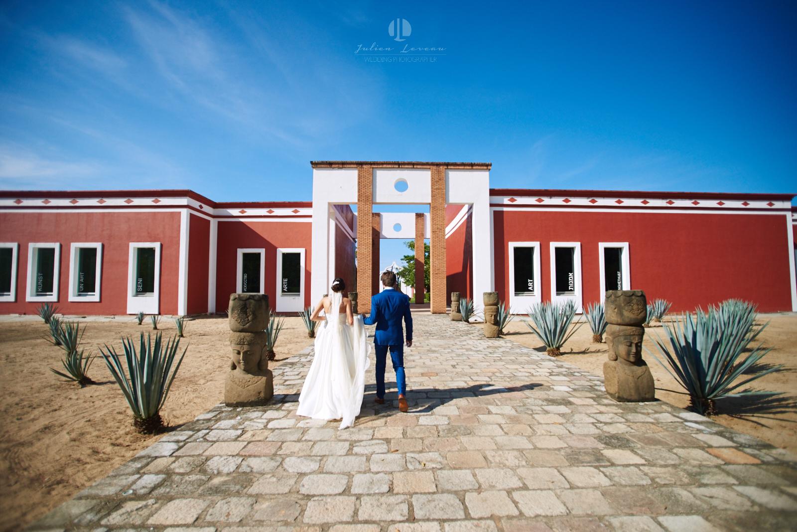 Wedding Photographer in San Pancho Nayarit - Couple walking towards the hacienda