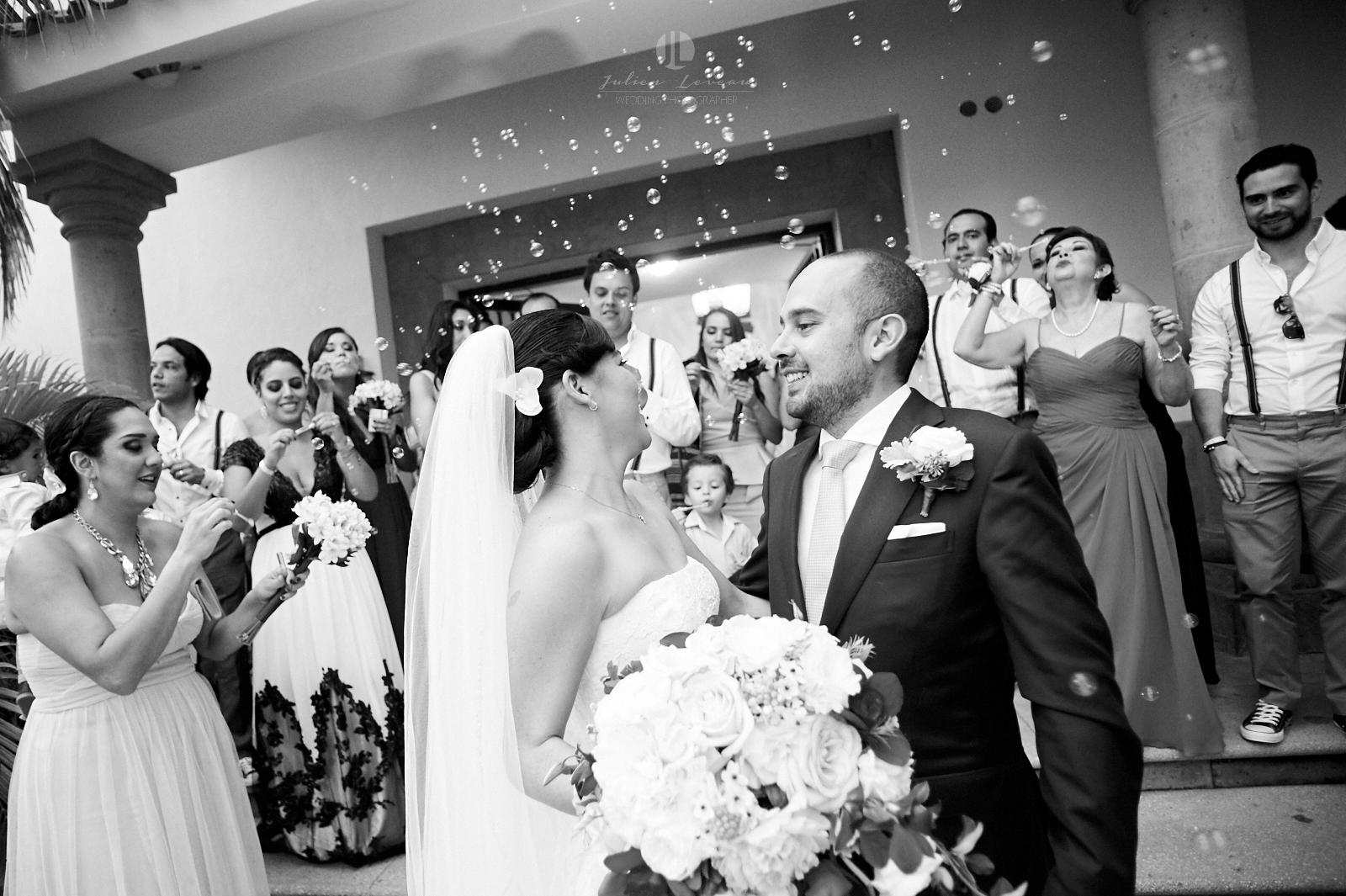 Wedding Photographer in Puerto Vallarta - Haapy couple leaves church