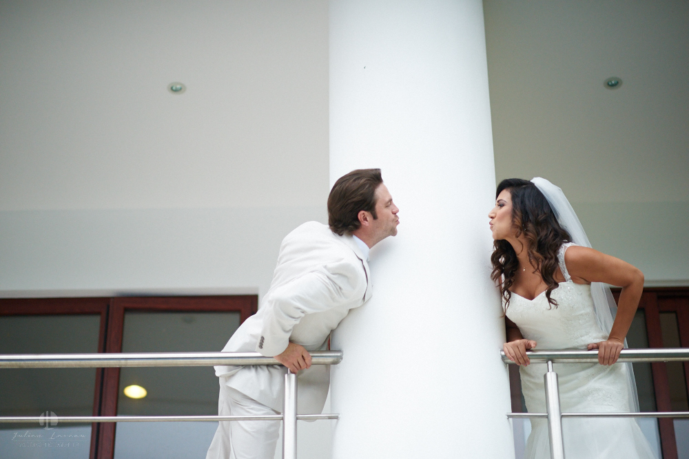 Professional Photographer in Puerto Vallarta - Real Wedding at Casa Karma - Getting ready kissing couple