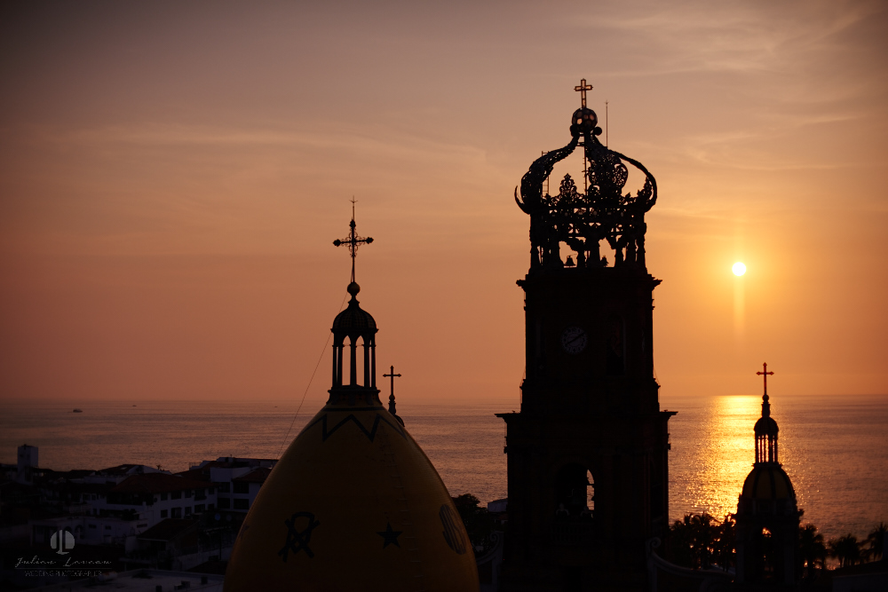 Professional wedding Photographer in Puerto Vallarta - Hacienda San Angel - artistic shot with church parroquia nuestr señora de guadalupe sunset view