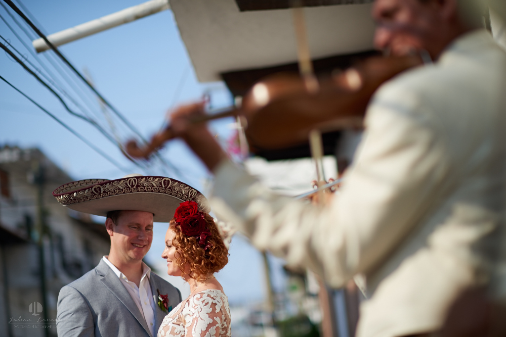 Professional wedding Photographer in Puerto Vallarta - Hacienda San Angel - artistic photography couple in the street with mariachis