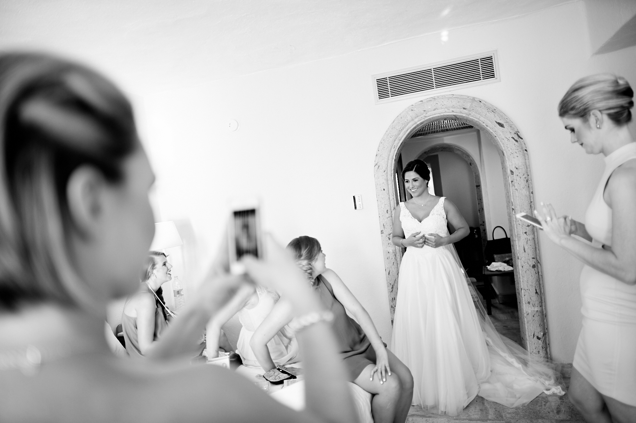 photojournalism - bride in her dress before her friends
